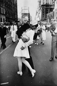 photojournalism - soldier kissing a women on valentines day